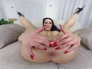 Desirable sex bomb with huge tatas creates mini earthquakes with her masturbation