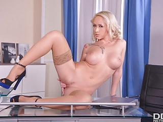 Sex-starved MILF massages her round melons and pretty pussy in the office