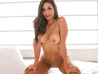 Stripping Latina with Sexy Fake Tits Gives a VR Bj