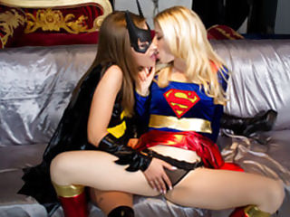 Batgirl's tongue covered with kryptonite makes Supergirl moan