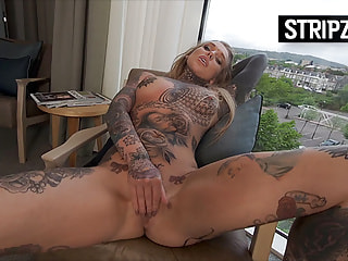Hotel Striptease from a Tattooed Girl in Lingerie